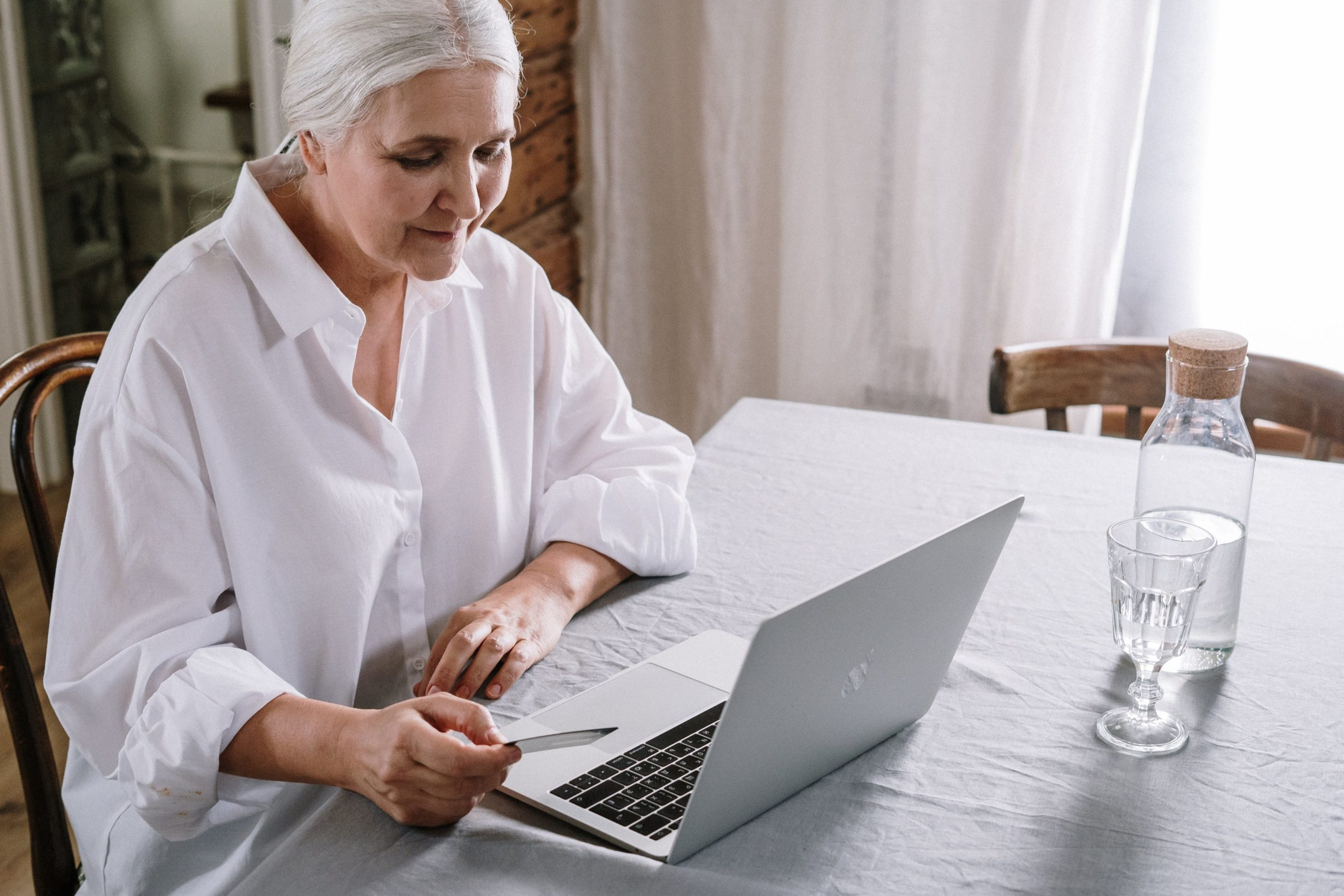 Older Lady on computer paying bills